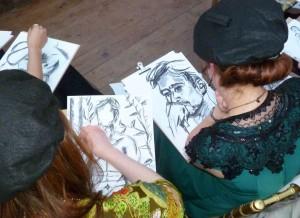 Immersed in their drawings..